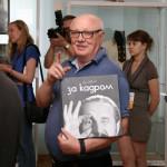 Сергей Васильевич Иванов с альбомом своих фотографий.