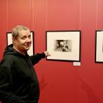 В.Щеколдин около своей работы нв выставке